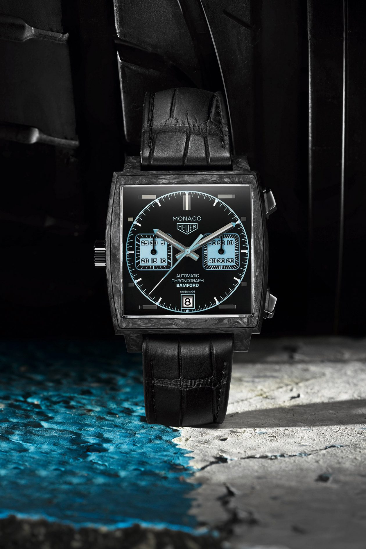 The carbon fiber copy watches have black leather straps.